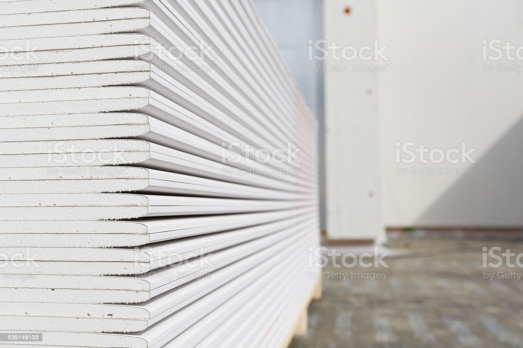 Stack of plasterboard panels stock photo