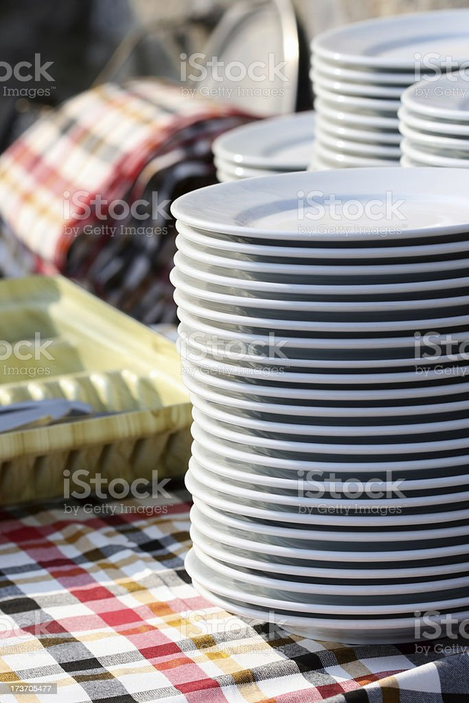 Stack of plates on the service table stock photo