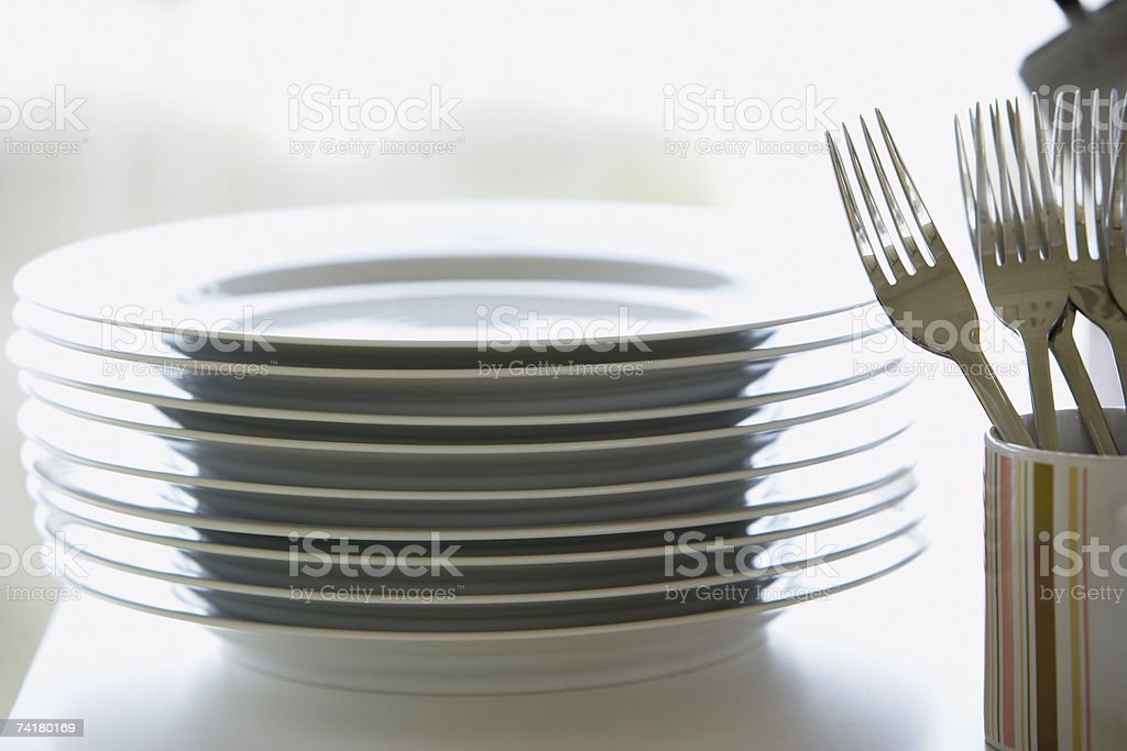 Stack of plates with forks in mug royalty-free stock photo