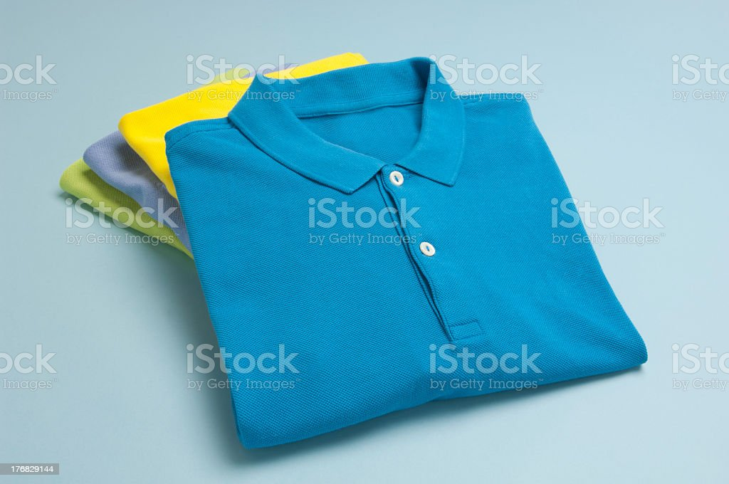 A stack of polo shirts in varying colors stock photo