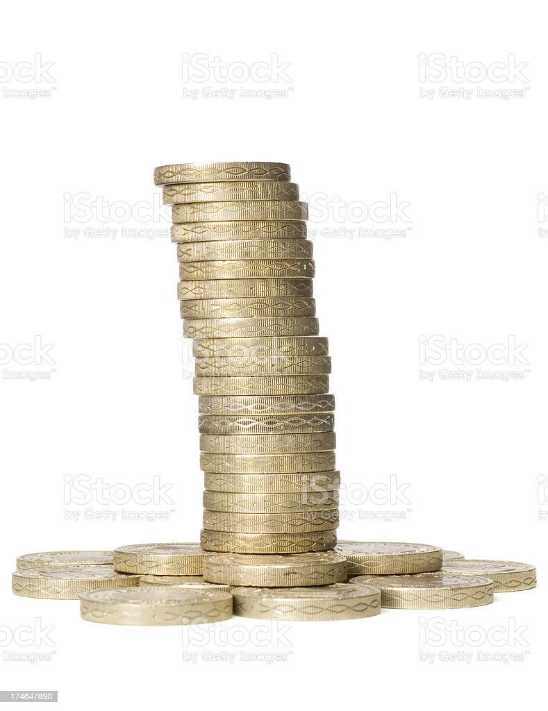 Stack of pound coins on white royalty-free stock photo