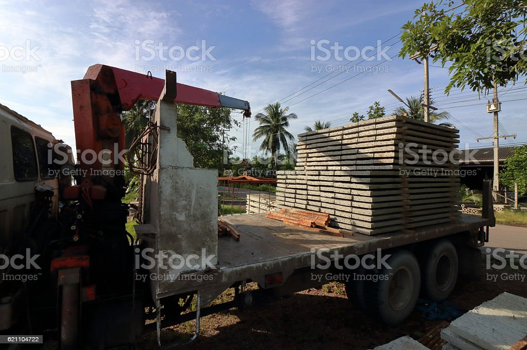Stack of prestressed concrete slabs loaded on truck for construction stock photo