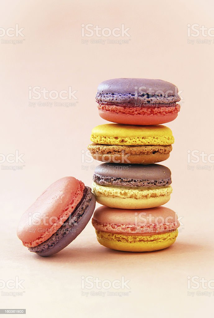 Stack of Pretty Purple, Pink, and Yellow Macarons royalty-free stock photo