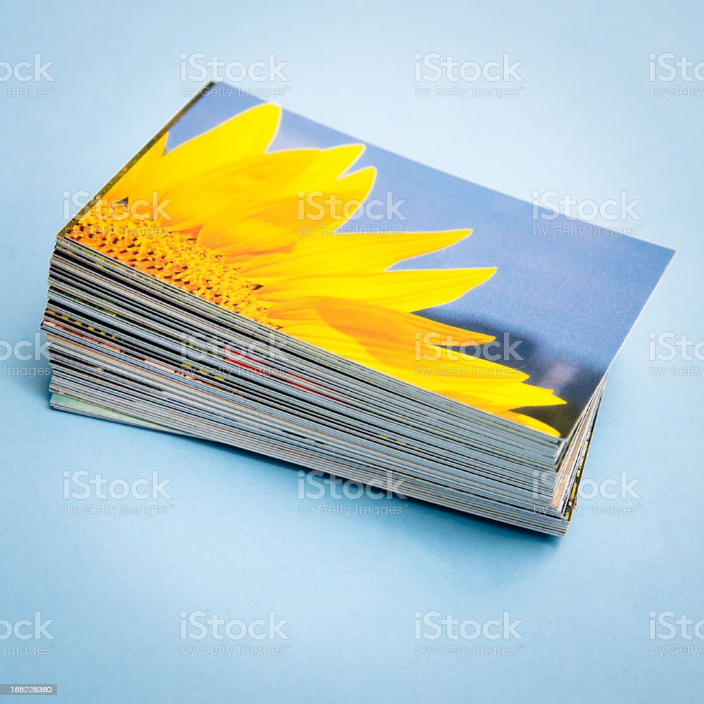 Stack of printed colorful images about spring sunflower stock photo