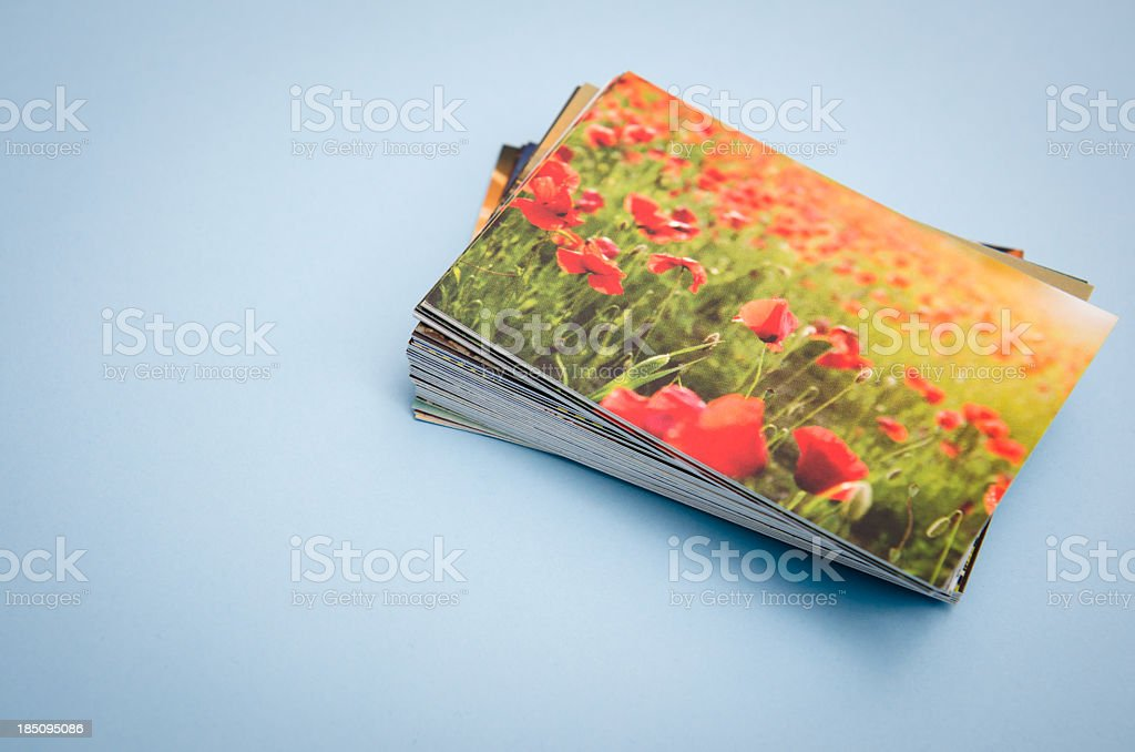 Stack of printed colorful images in spring field stock photo
