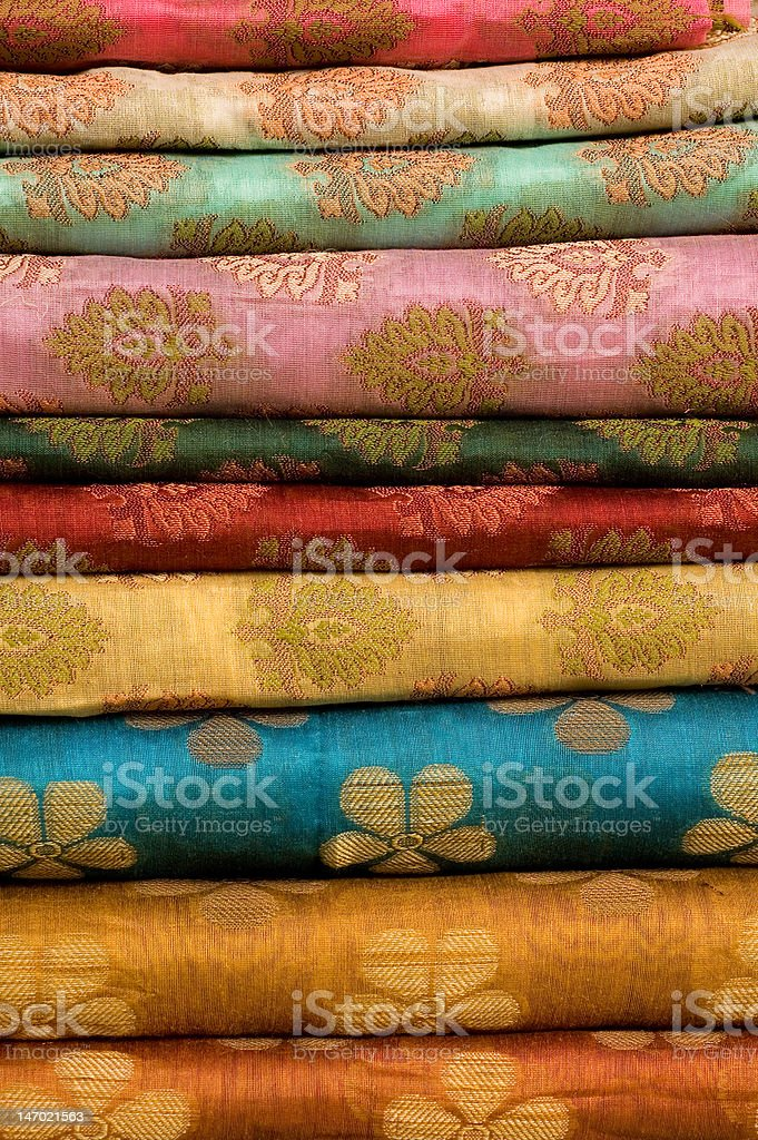 Stack of printed silk fabrics royalty-free stock photo