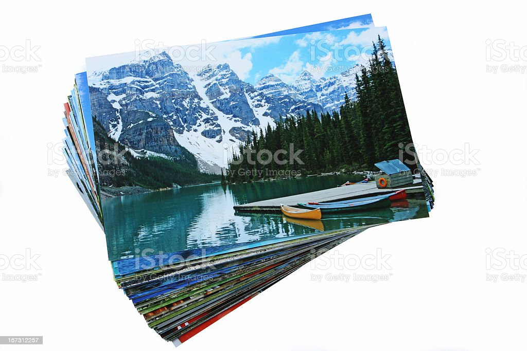 Stack of Printed Vacation Photographs on White Background stock photo