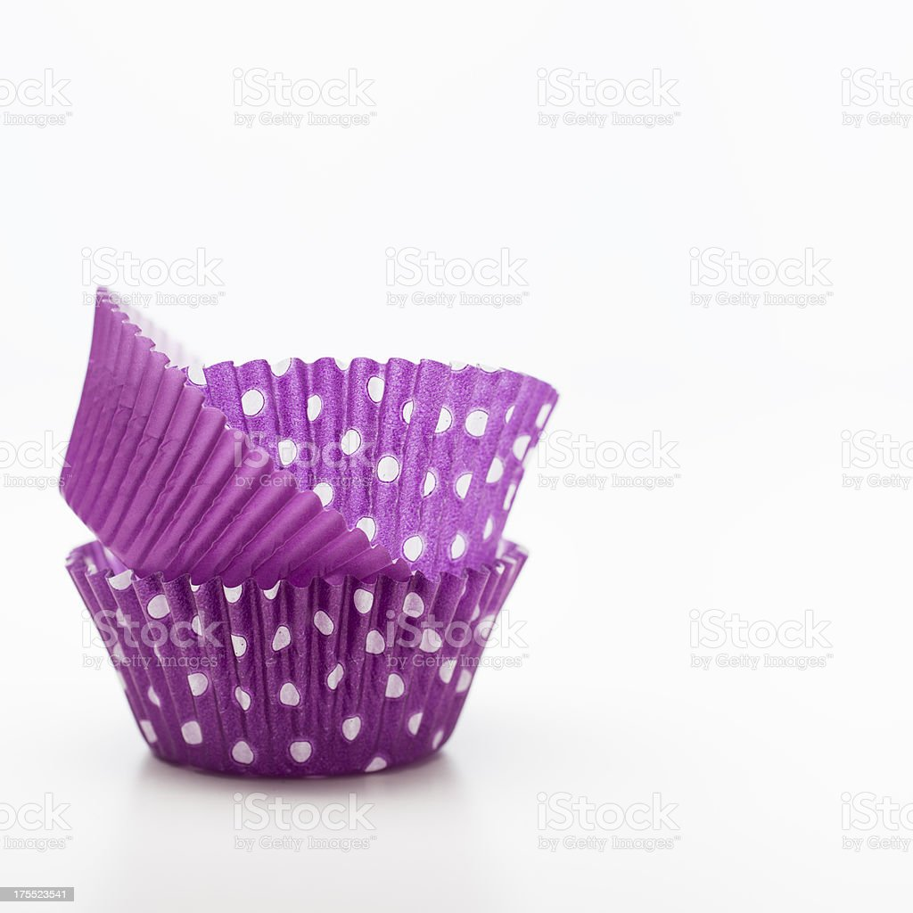 Stack of Purple Cupcake Liners with Copy Space stock photo