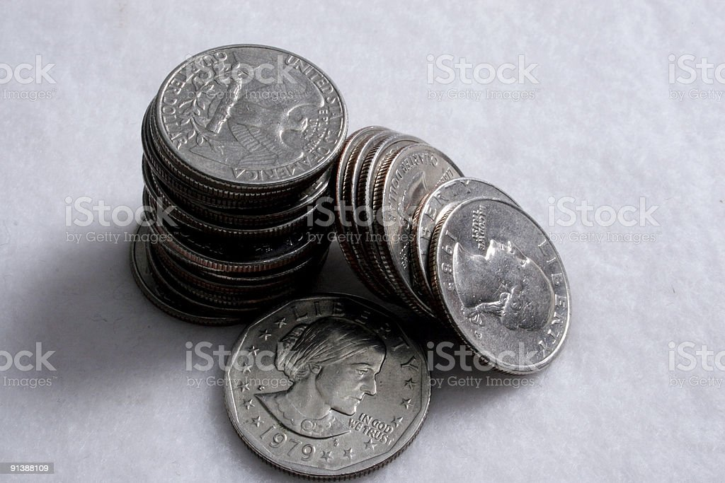 Stack of Quarters and a Dollar stock photo