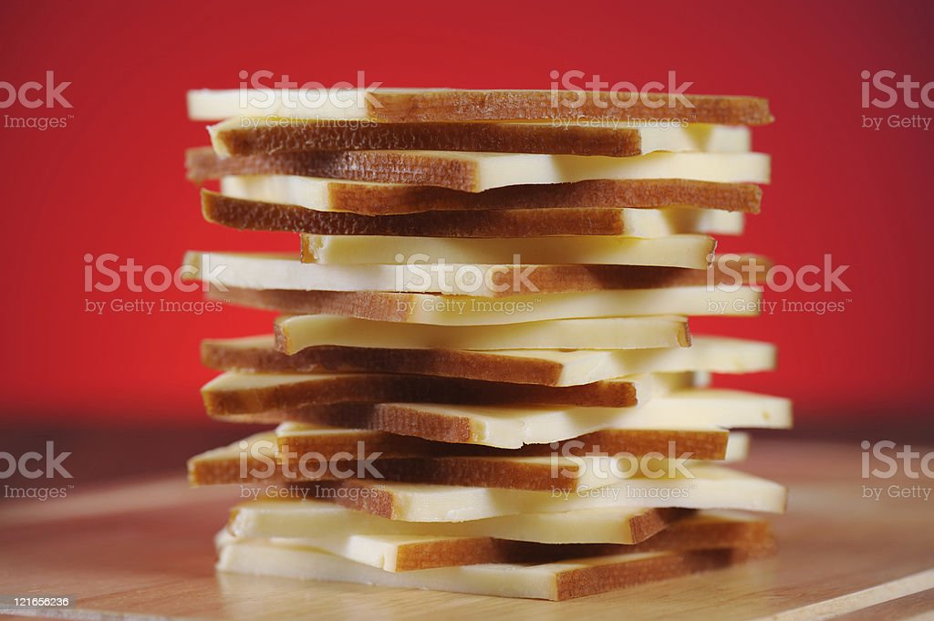 Stack of Raclette Cheese Red Background stock photo