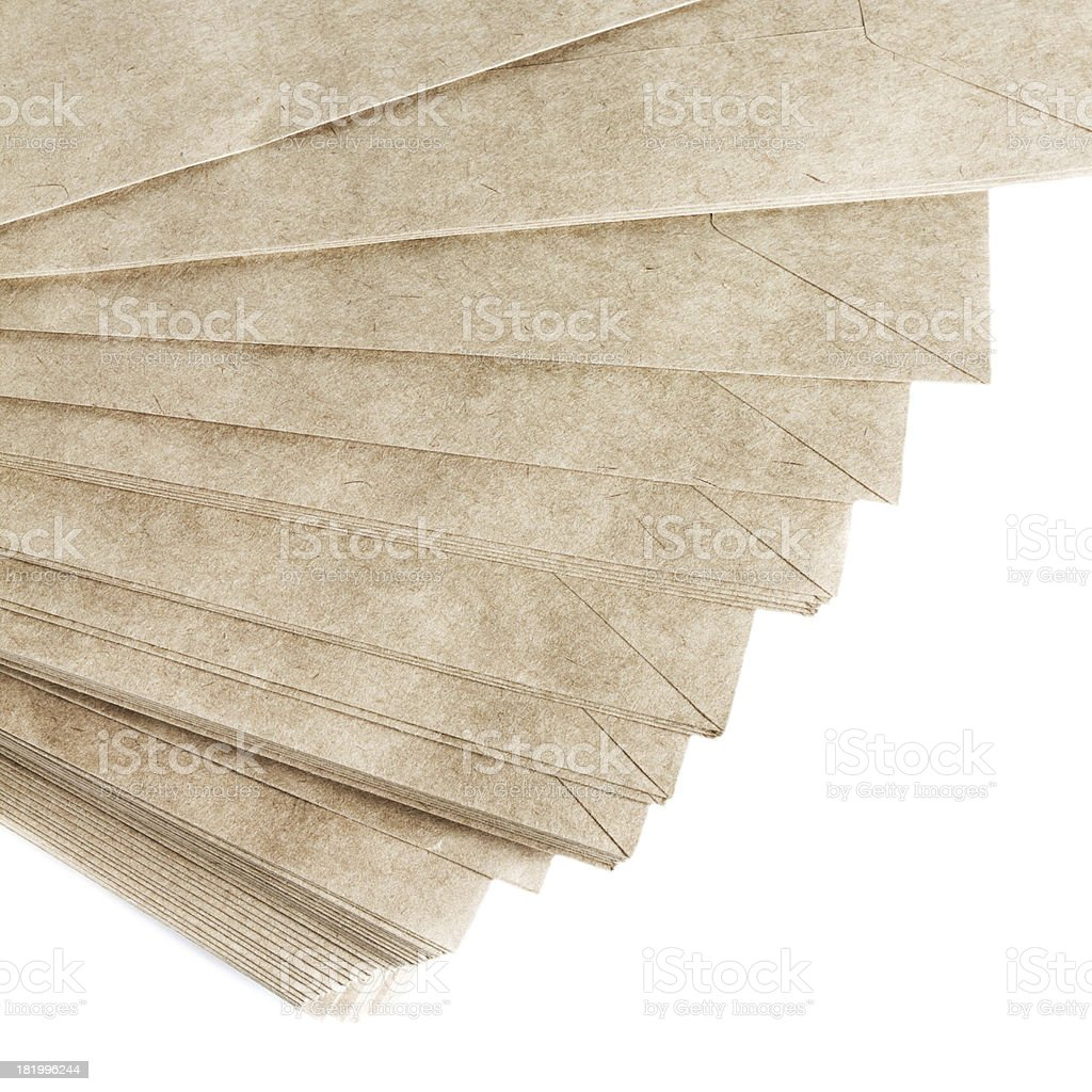 Stack Of Recycled Paper envelopes isolated on white background, royalty-free stock photo