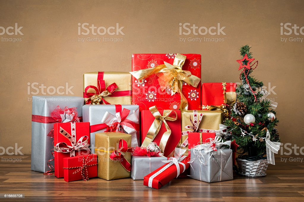 stack of red, silver and golden gifts stock photo