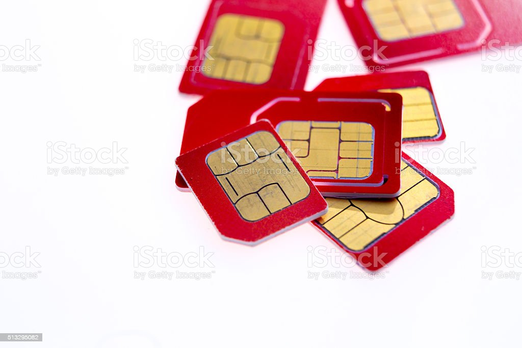 Stack of red sim card on white background stock photo