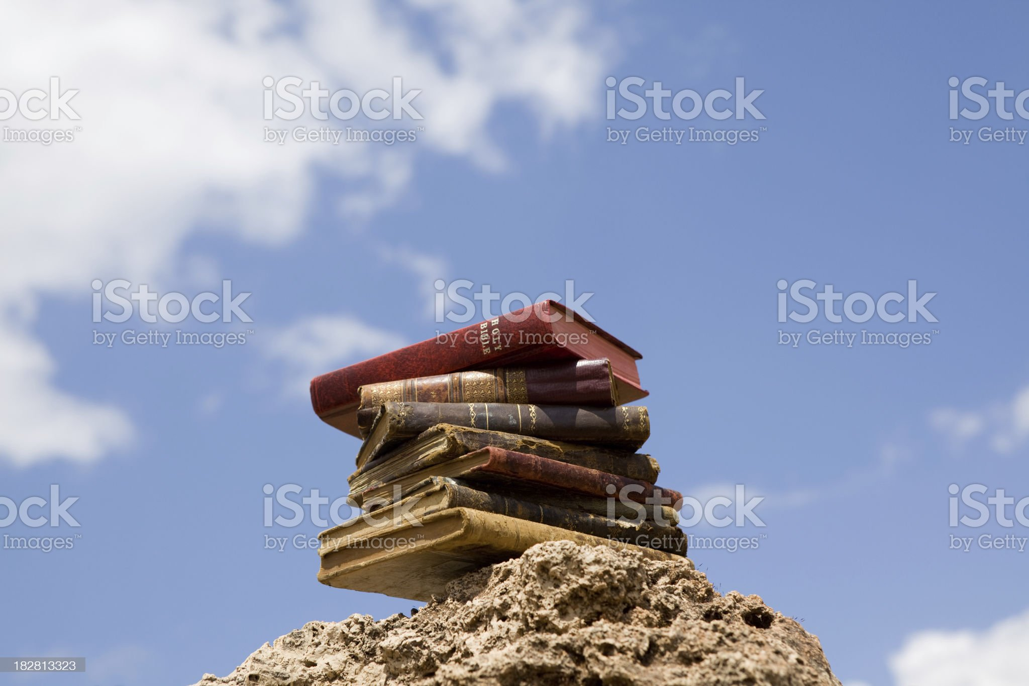 Stack of religious old books on rock royalty-free stock photo