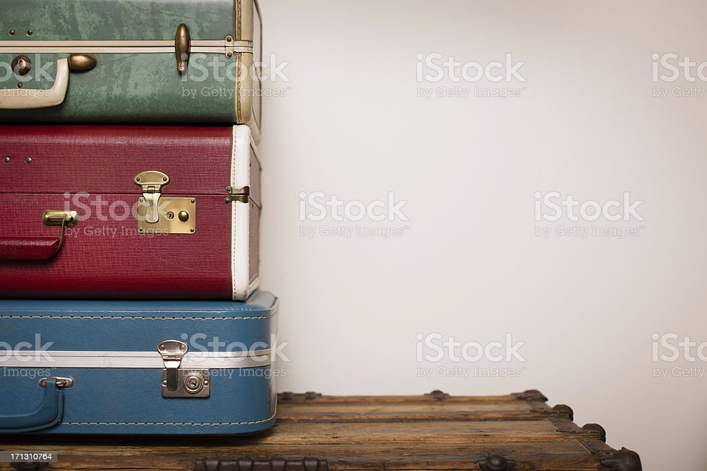 'Stack of Retro Suitcases, Sitting on Wood, With Copy Space' stock photo