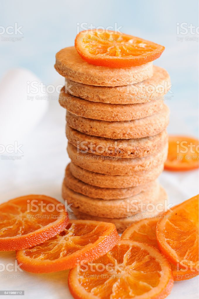 Stack of round shortbread and candied oranges stock photo
