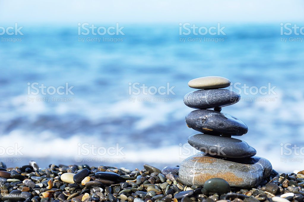 Stack of round stones on the seashore stock photo