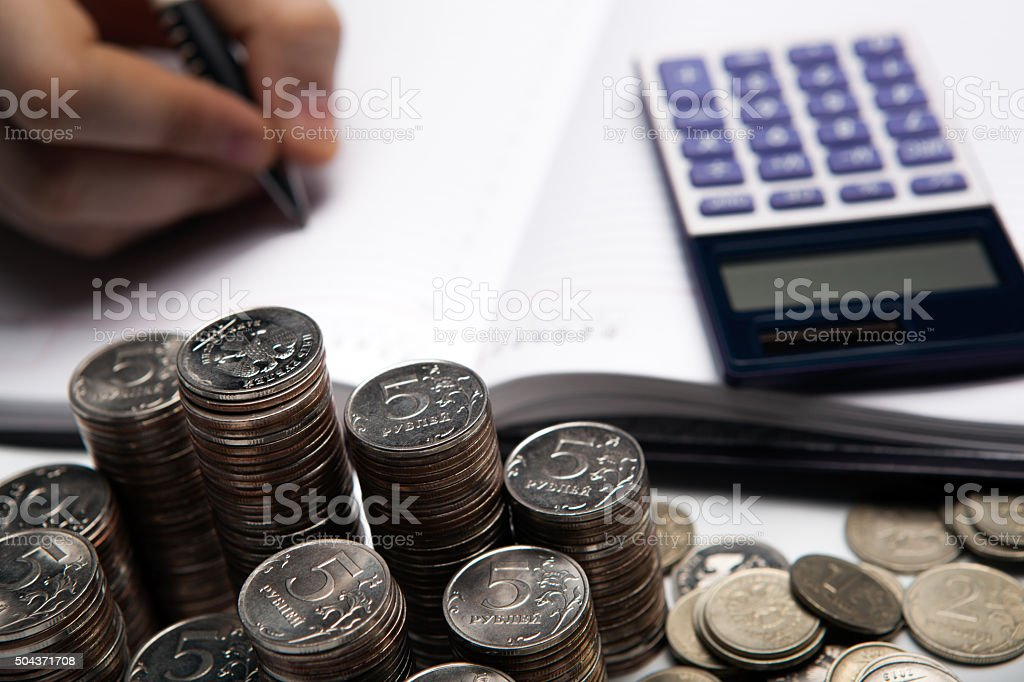 stack of Russian coins and accountant stock photo