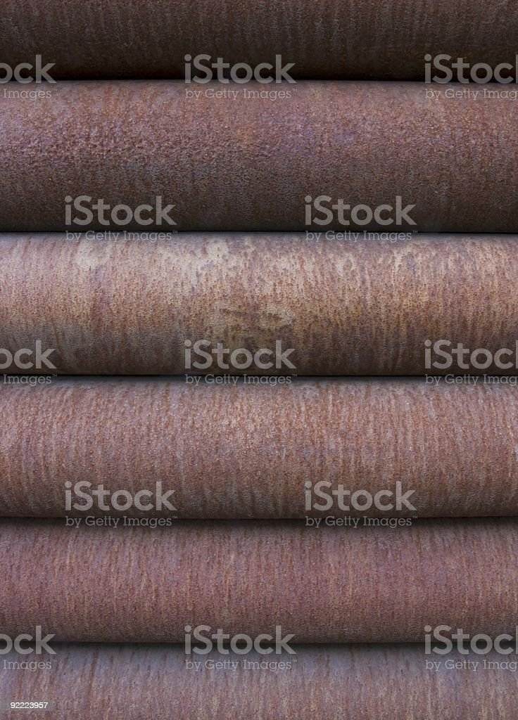 Stack of rusty steel pipes royalty-free stock photo