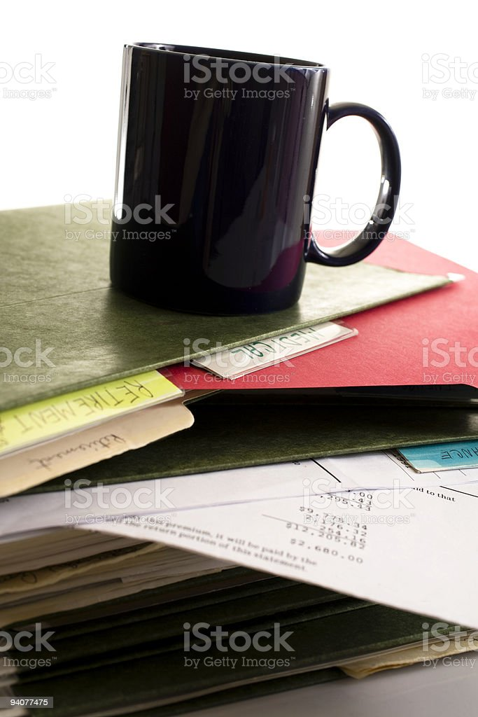 Stack of scattered file folders with coffee cup on top royalty-free stock photo