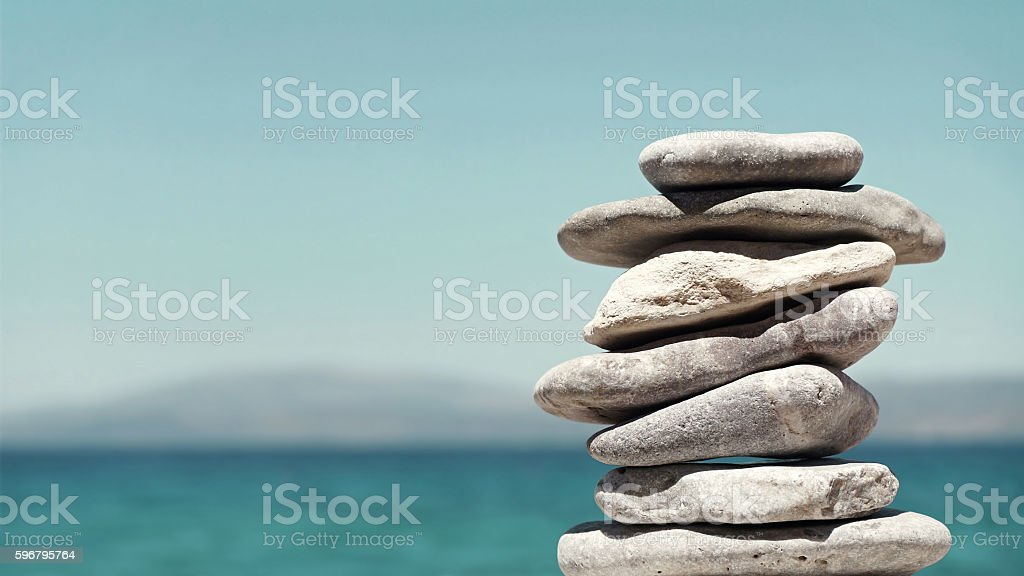 Stack of Sea Pebbles on a Calm Sea Background stock photo