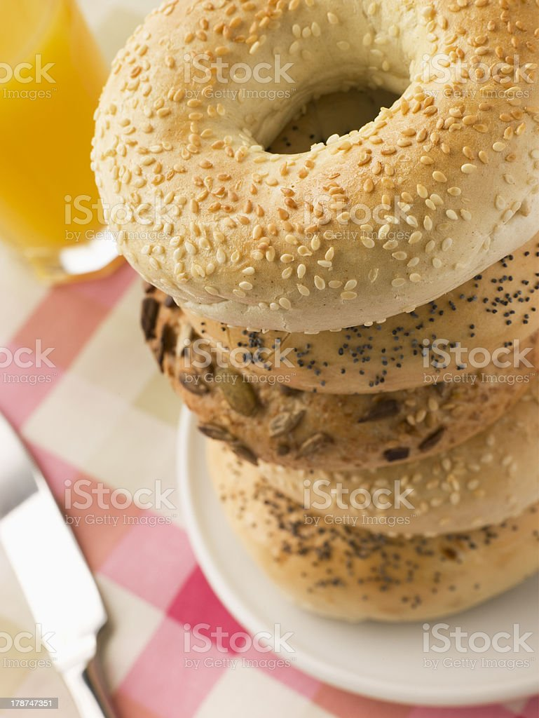 Stack of Seeded Bagels with Orange Juice royalty-free stock photo