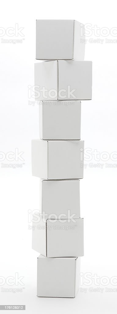 Stack of seven white boxes isolated royalty-free stock photo