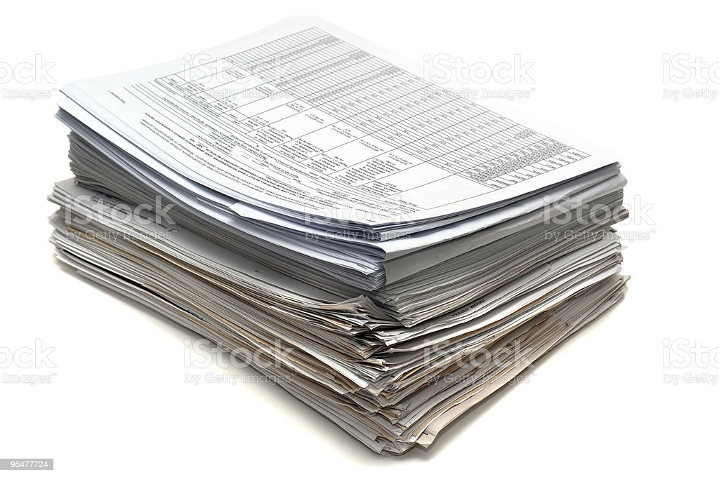 A stack of several documents with a white background stock photo