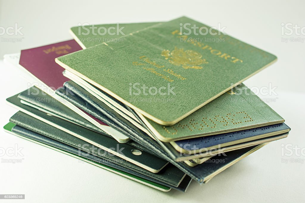 Stack of several old and cancelled passports, primarily USA stock photo