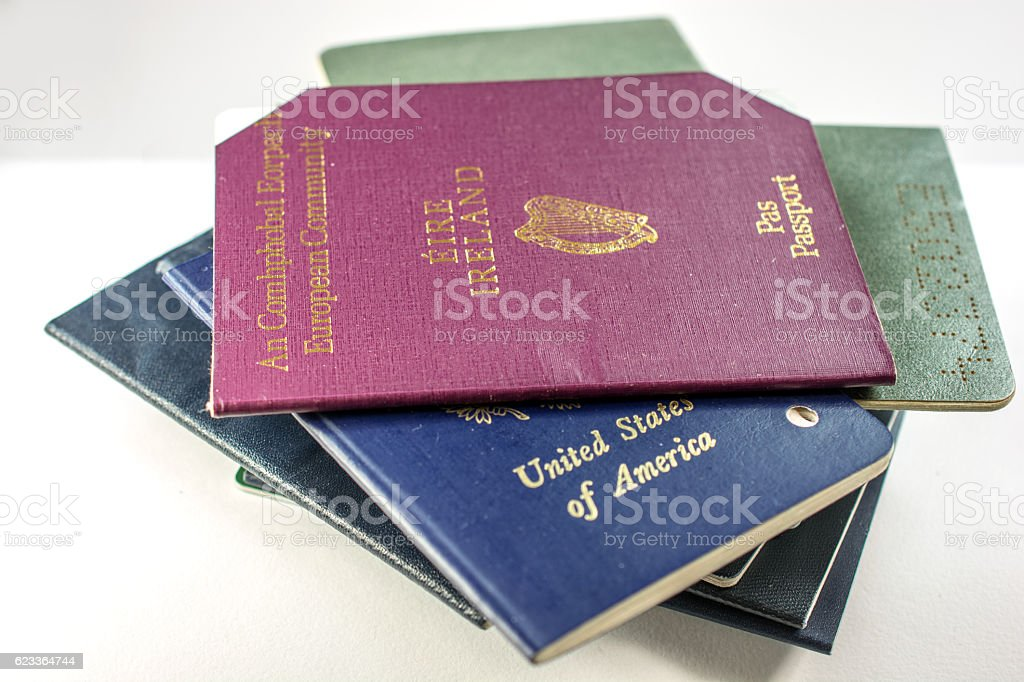 Stack of several old and cancelled passports,  USA and Irish stock photo
