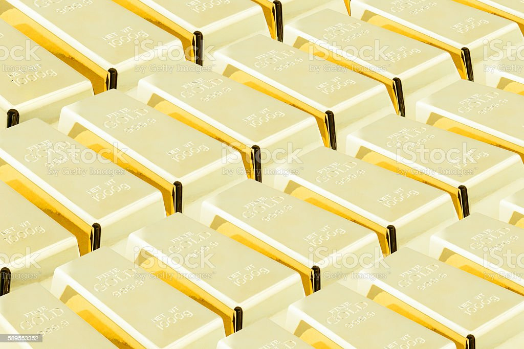 Stack of shiny gold bars / ingots in the vault stock photo
