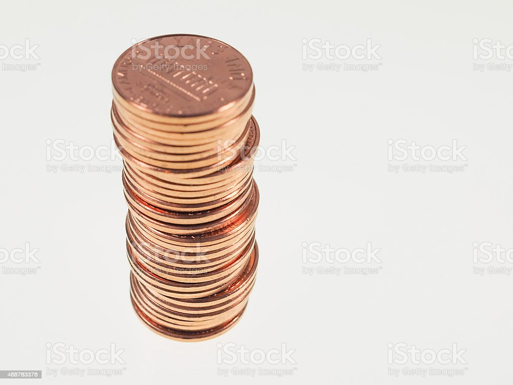 Stack of shiny pennies isolated on white background stock photo