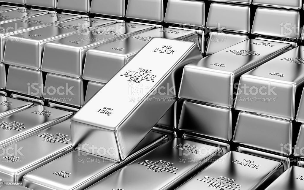 Stack of shiny silver bars inside a bank vault stock photo