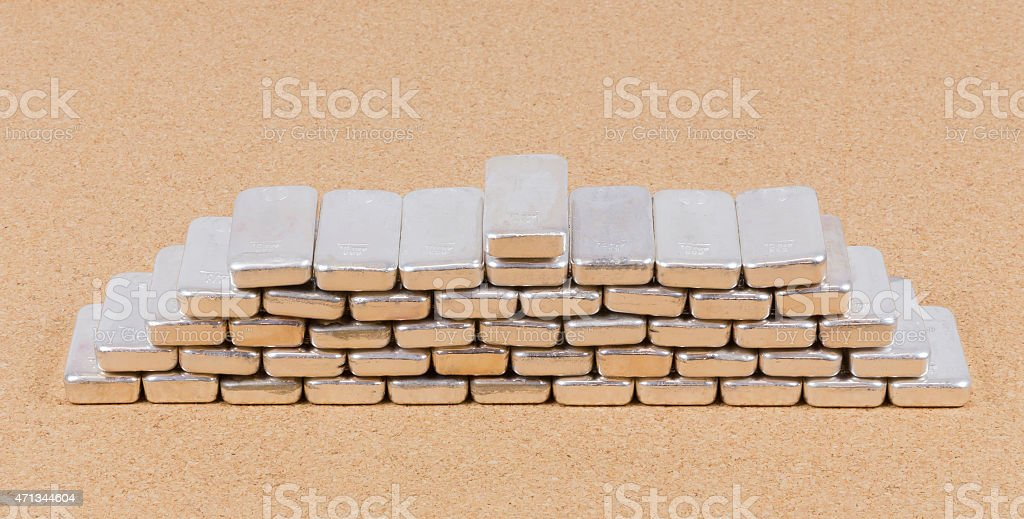 Stack of Silver Bricks in Semi Pyramid stock photo