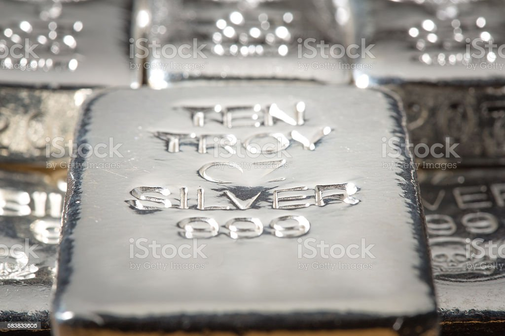 Stack of Silver Bullion Bars & Ingots stock photo