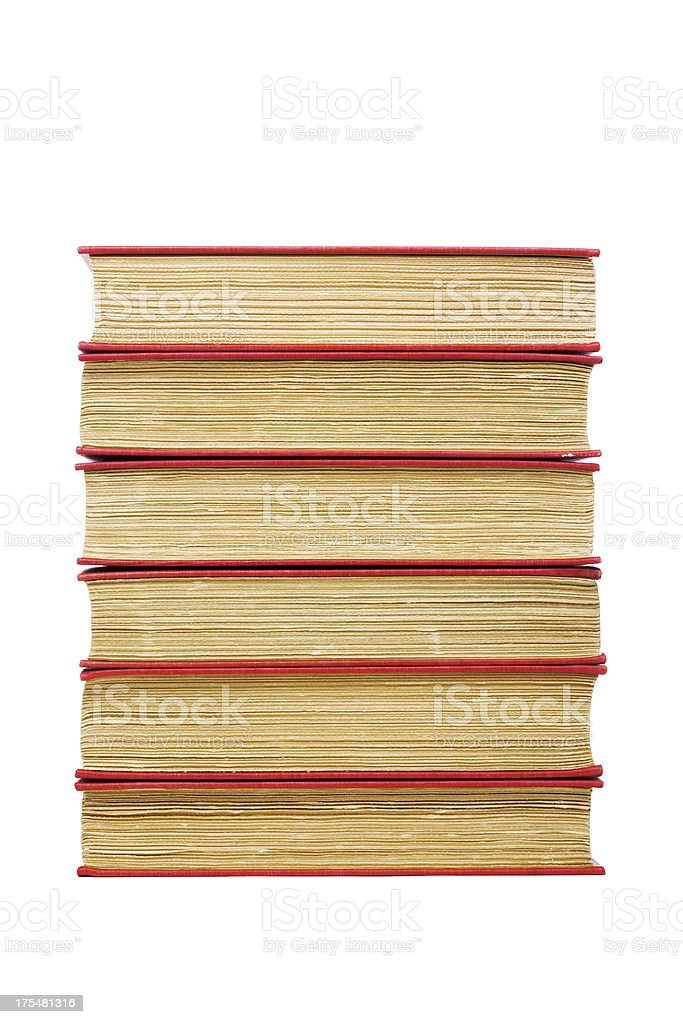 Stack of six old hardcover books with roughly trimmed edges royalty-free stock photo