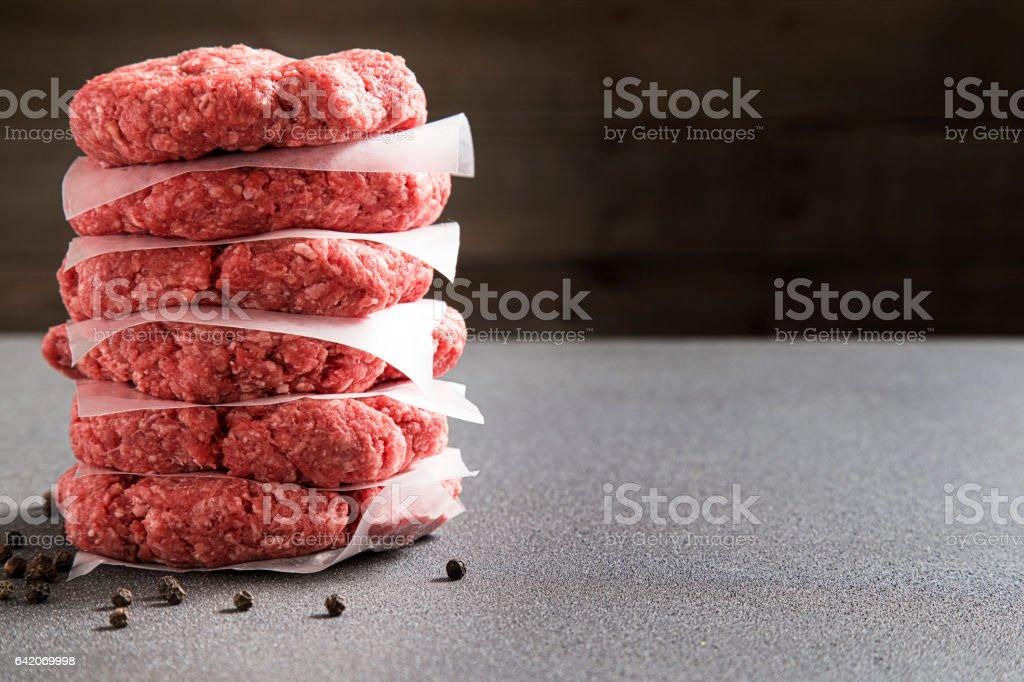Stack of Six Raw Hamburgers stock photo