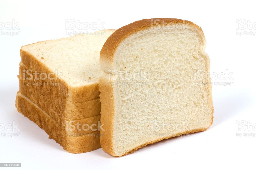 Stack of sliced white loaf of bread stock photo