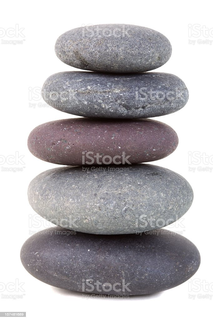 Stack of smooth stones isolated on white stock photo