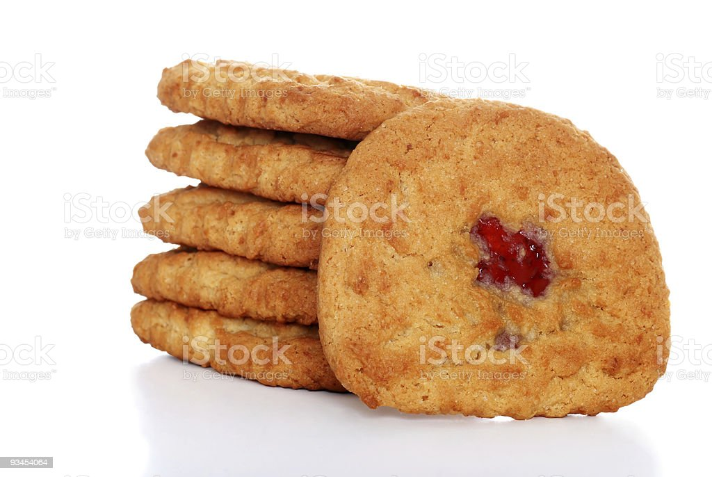 stack of soft chewy strawberry filled cookies stock photo
