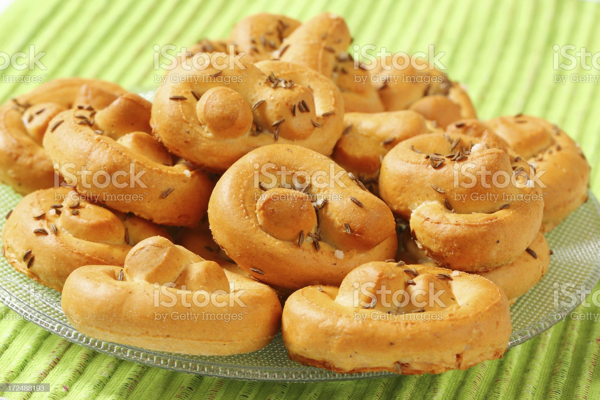 Stack of soft pretzels on a glass plate royalty-free stock photo