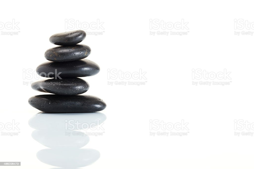 Stack of spa hot stones stock photo