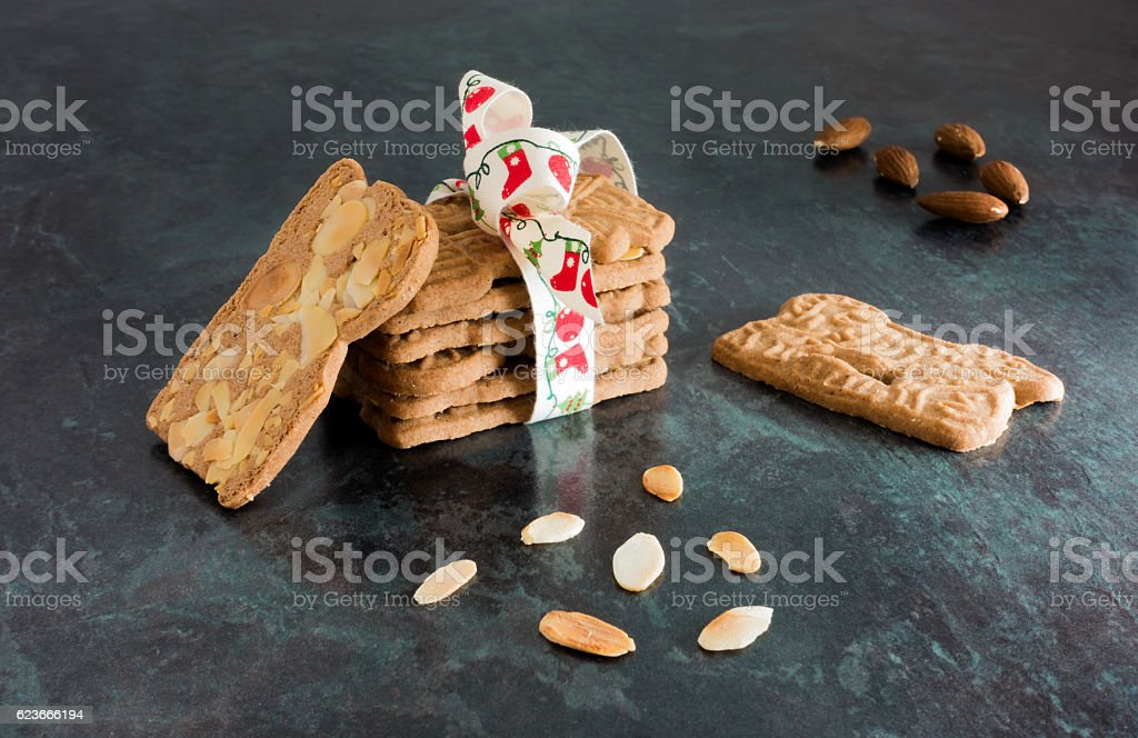 Stack of Spiced Biscuits with Almonds ( Spekulatius ) on Black stock photo