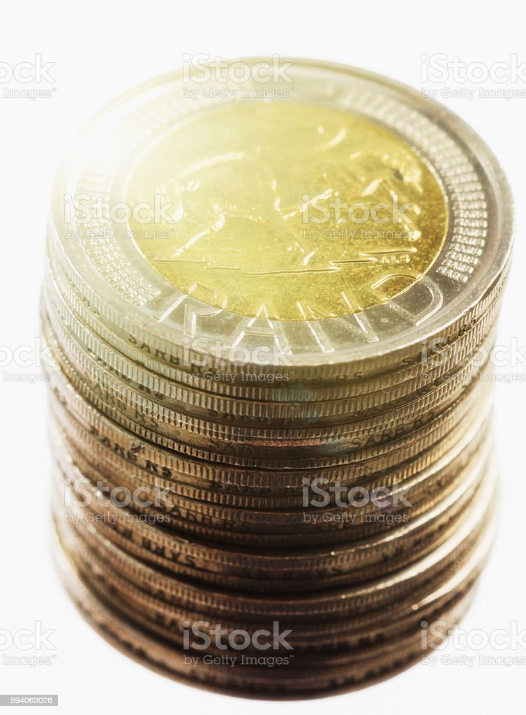 Stack of spotlit South African Five Rand coins stock photo