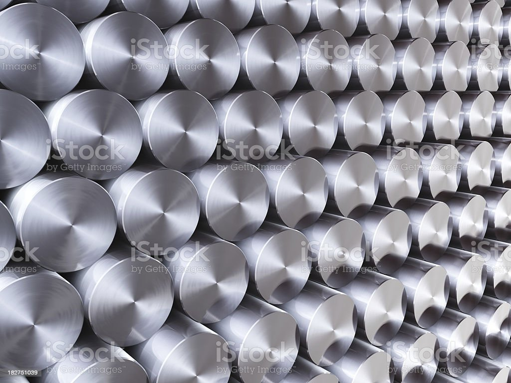 Stack of stainless steel rods background stock photo