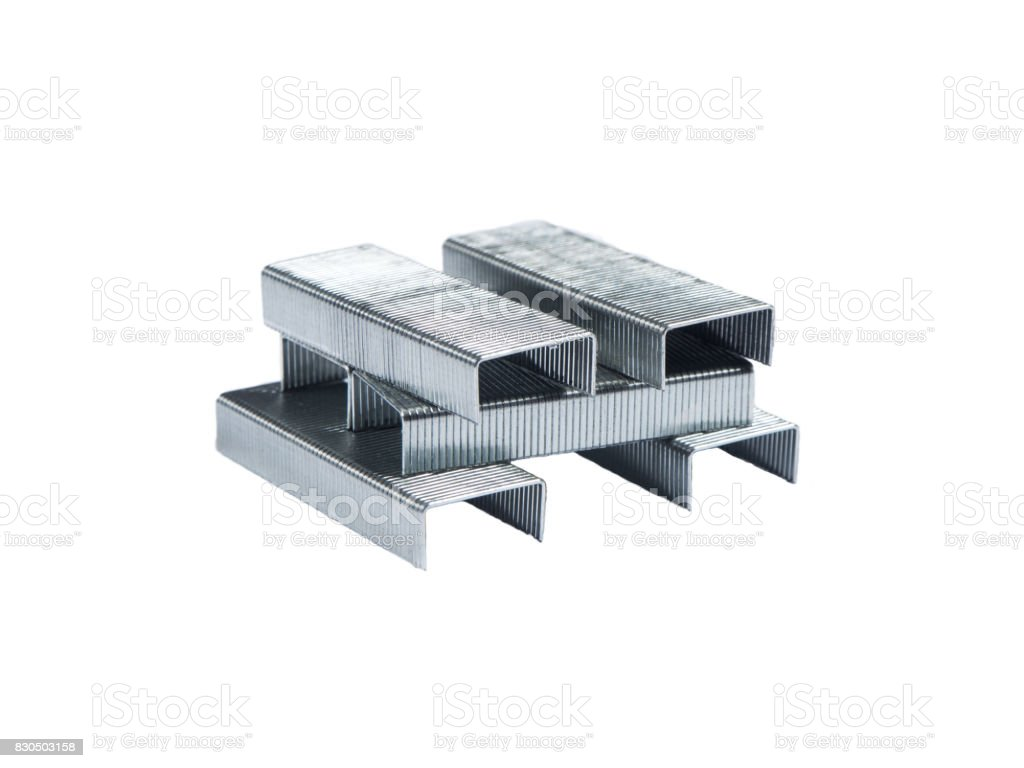 Stack of stapler steel pins on white isolated background stock photo