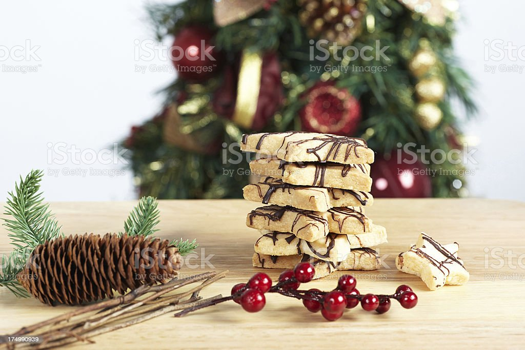 Stack of star cookies with christmas decorations on table royalty-free stock photo