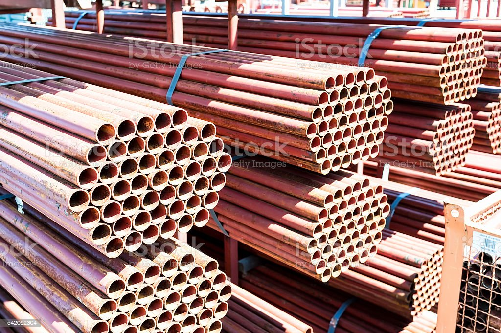 Stack of steel pipes for scaffolding in stock. stock photo