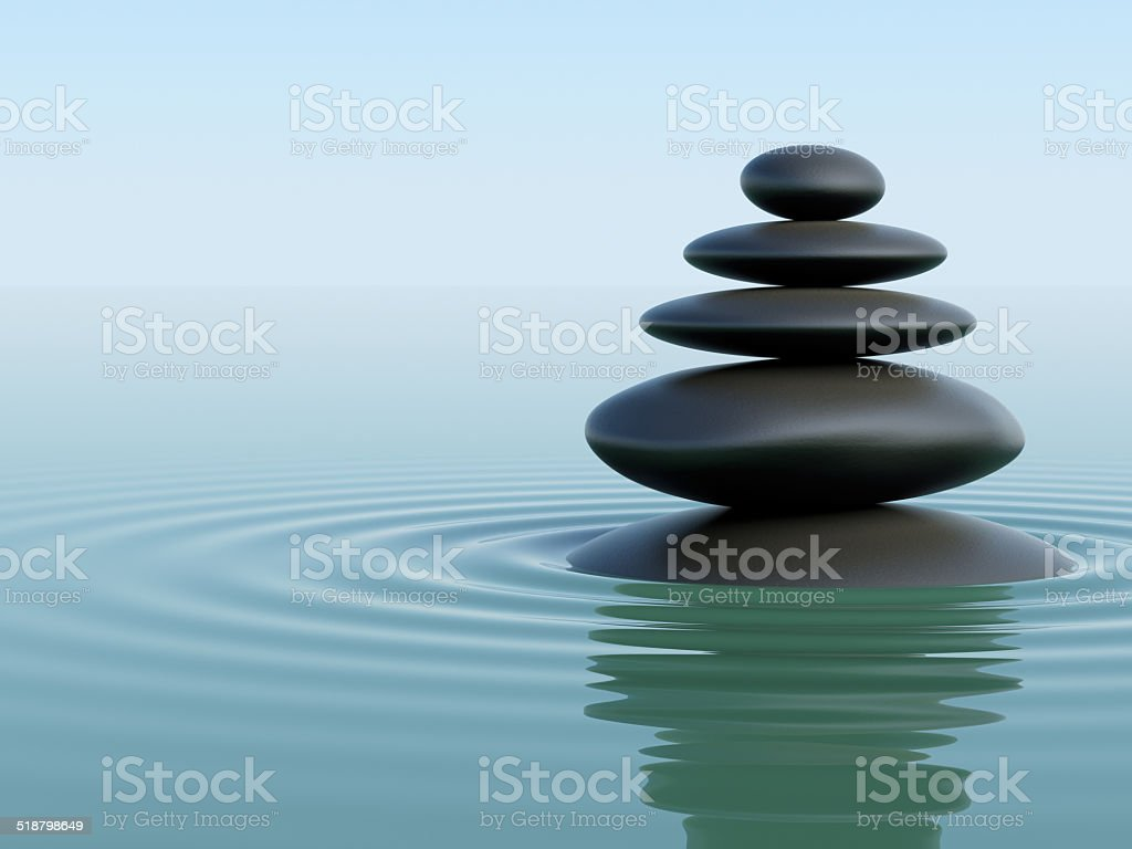 Stack of stones in the ocean stock photo