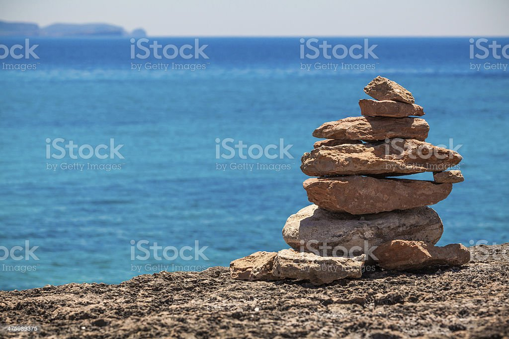 stack of stones on the beach and sea background. stock photo